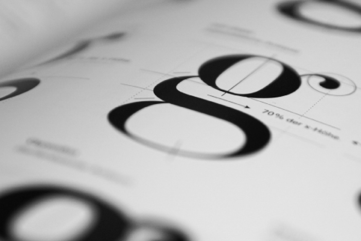 Close Up of Typography Book, Showing a Lowercase Letter G