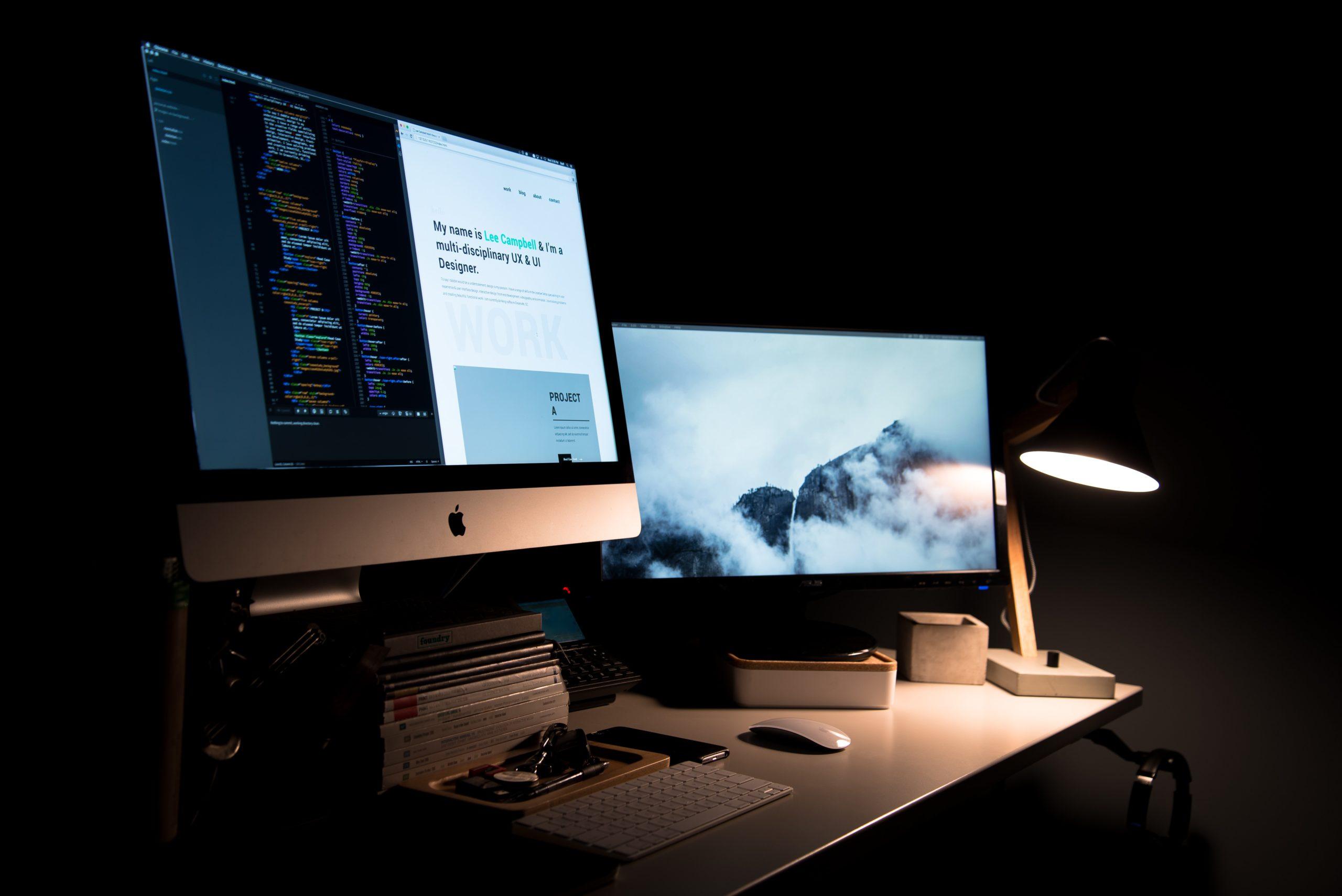 iMac Screen Showing Website Design and Backend Web Development Coding