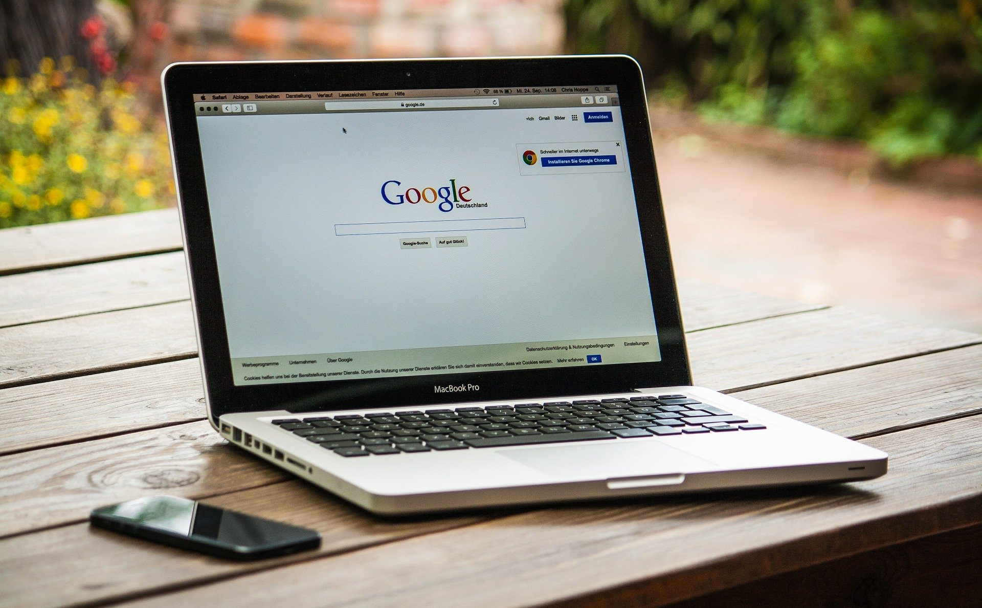 Google Search on Silver MacBook Air Located on Light Wooden Table