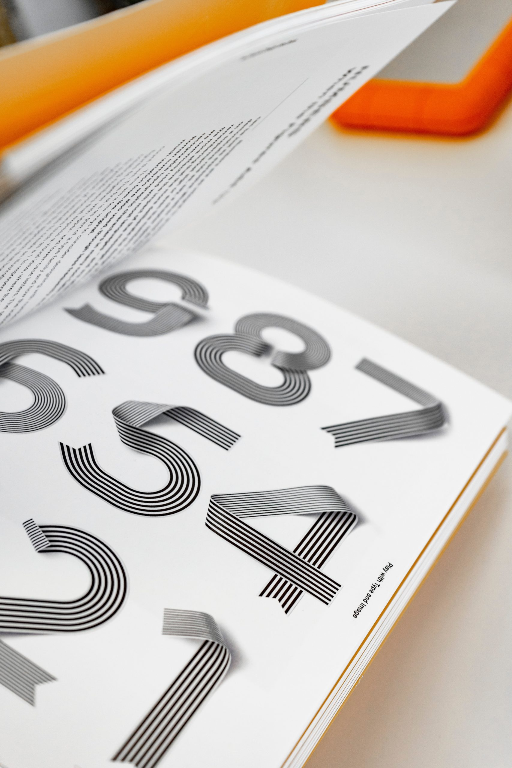 Close Up of Book with 3D Numbers, Listed in Reverse Order From 9 to 1