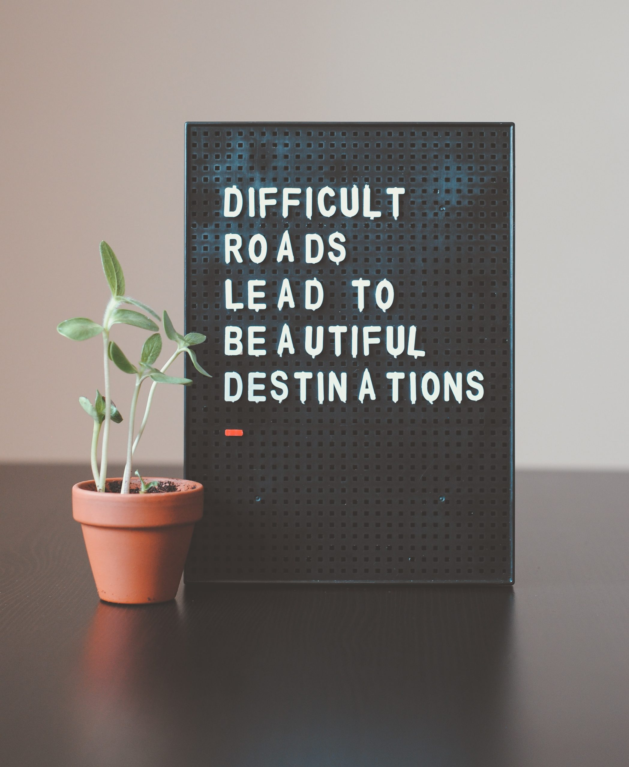 """Black Letter Board Saying """"Difficult Roads Lead to Beautiful Destinations"""""""