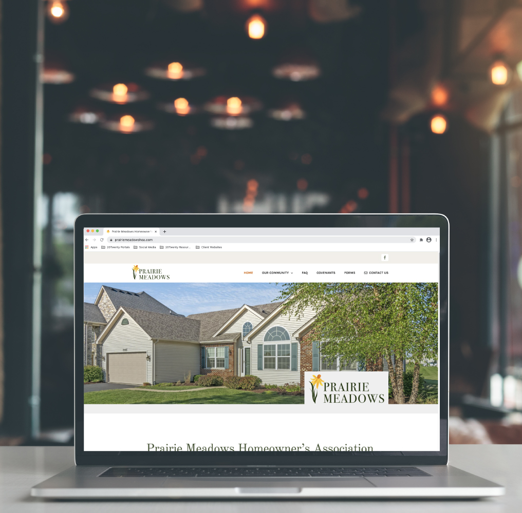 Prairie Meadows HOA Website Design on Laptop