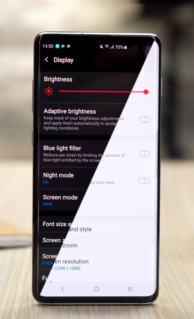 Cell Phone with Split Screen Featuring Dark Mode and Light Mode