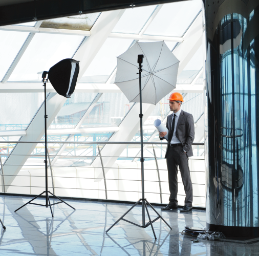 Architect posed with photography lighting in modern building