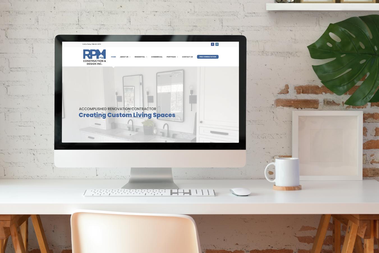 RPM Construction & Design Website on Desktop Screen