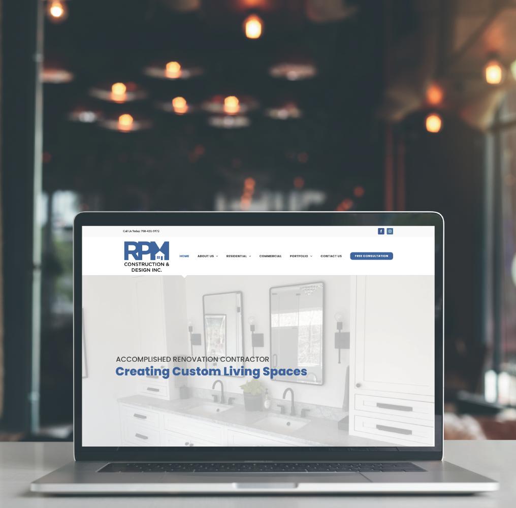 RPM Construction & Design Website on Laptop Screen