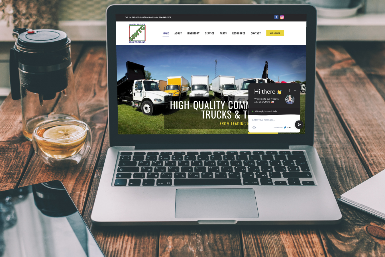 Hodges Westside Truck Center Website on Laptop Screen