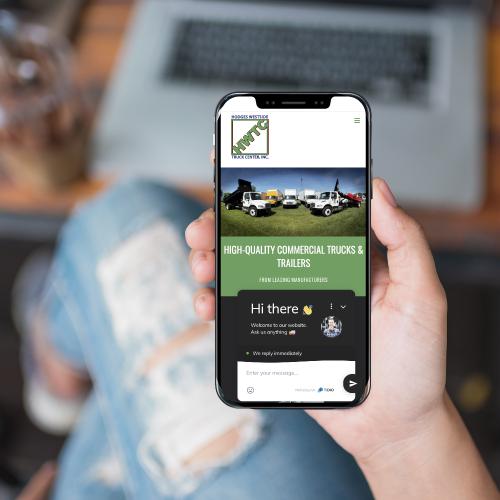 Hodges Westside Truck Center Website on Smartphone Screen